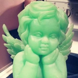 This glow in the dark cherub sits on my Ma's kitchen counter.